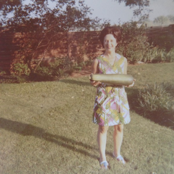 My mother holding one of her prized zucchinis!