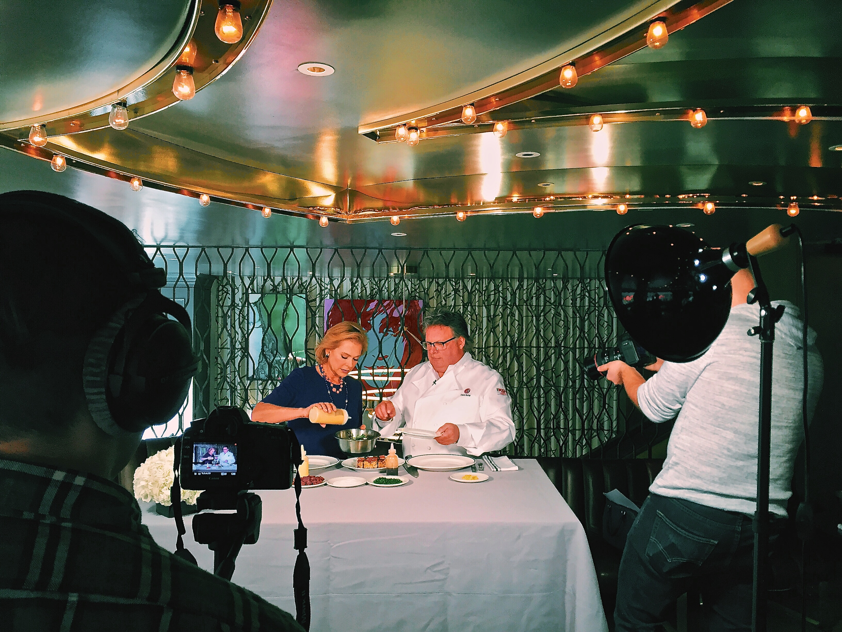 Behind the Scene shot of Pamela and Chef David Burke Cooking